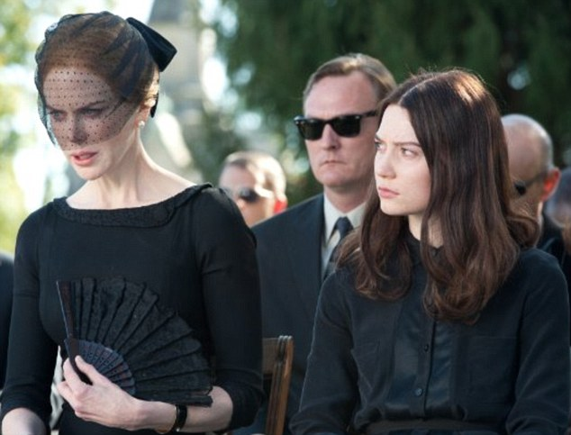 Grieving widow? Nicole Kidman dons all black for a funeral in a still for her new horror movie Stoker