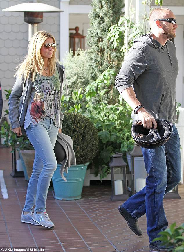 Skintight alright: Heidi paired the attire with some light denim skinny jeans, which expertly displayed her long slender legs, and some New Balance trainers