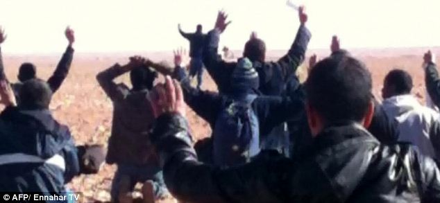 A still image broadcast today by Algeria's Ennahar TV shows hostages surrendering to Islamist gunmen who overtook a gas facility