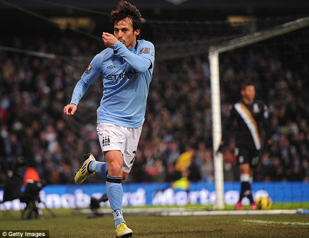 Spanish sensation: David Silva scored both goals as Manchester City beat Fulham at the Etihad Stadium