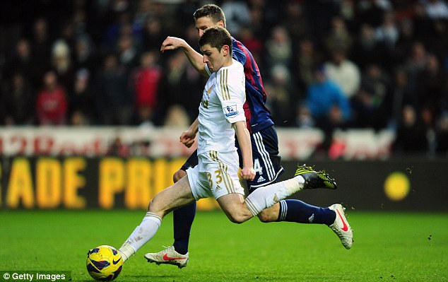 Letting fly: Defender Ben Davies opened the scoring for Swansea against Stoke