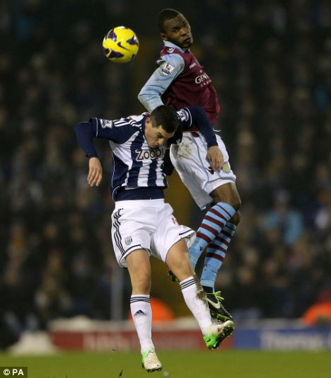 Battle: Villa's Christian Benteke (right) scored with a rocket to open the scoring