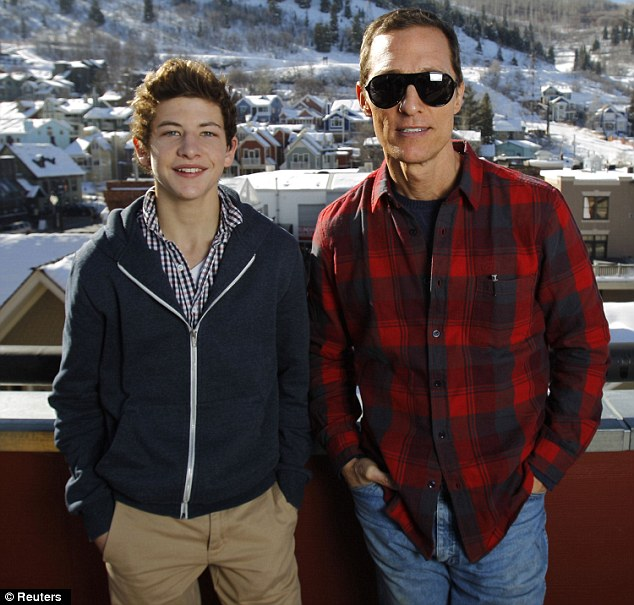 Rugged: Matthew cut a more muscular figure next to his Mud co-star Tye Sheridan as they posed during a junket for Mud