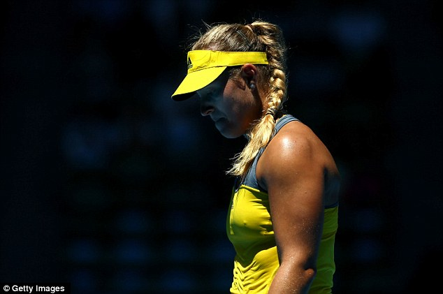 Down and out: Kerber shows her emotion as she loses to Makarova