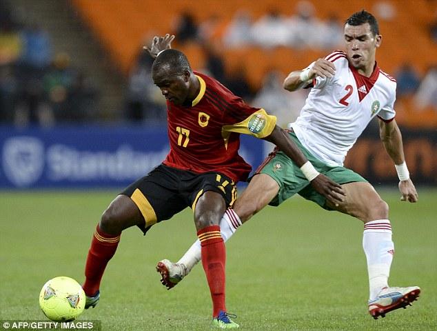 Strength: Angola forward Mateus holds off Achchakir