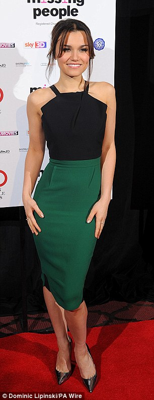 Style statement: Samantha Banks showed off her tiny frame in a clinging black and green dress