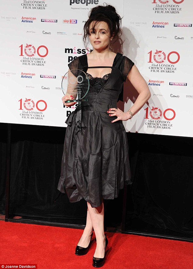 Winning look: Helena Bonham Carter shows off her award as she shines on stage at the ceremony