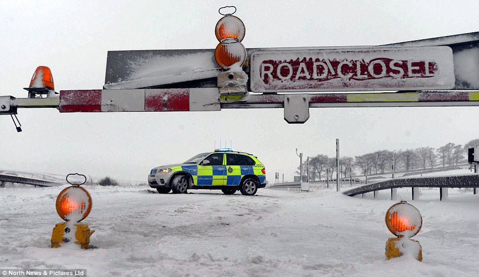 Warnings: The emergency services are still advising people not to travel unless they have to as roads are 'treacherous'
