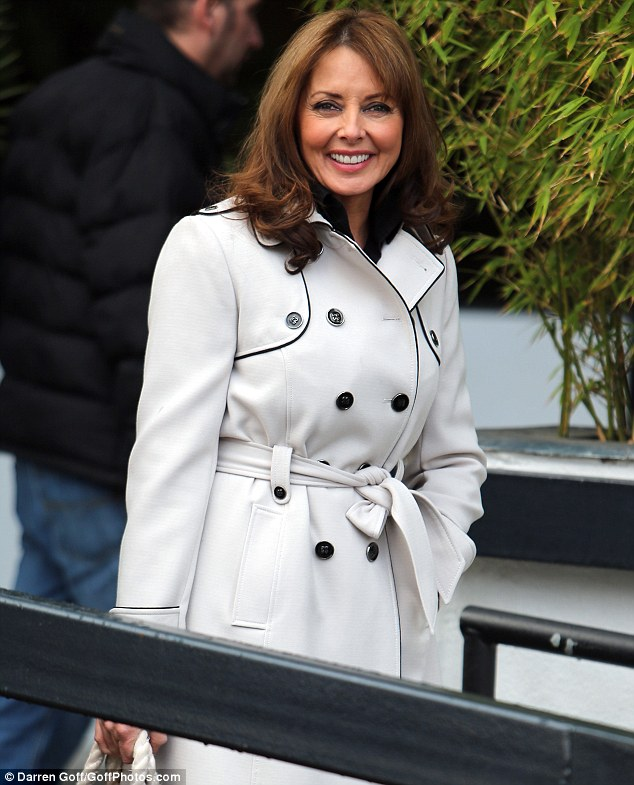 Happy Monday! Carol looks considerably chirpy as she leaves ITV studios, perhaps because of her new Twitter fan club