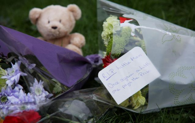 Goodbyes: One of the floral tributes is addressed, 'RIP, Little Man'
