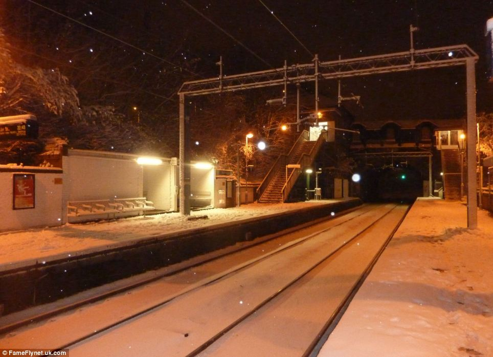 Delays: Snow was still falling in Stamford Hill, North London, this morning, with a blanket settling on the station platforms. Commuters have been warned to expect cancellations