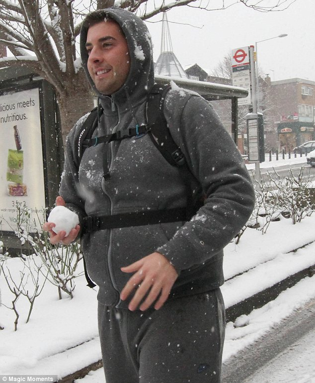Argy bargy: Mark's best friend Arg was seen having a snowball fight in Epping on Sunday