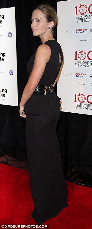 Eye-catching: The star stood out in a floor-length, figure-hugging dress as she hit the red carpet