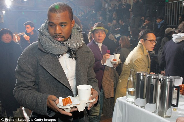So lonely: Kanye had to negotiate the refreshment stand by himself