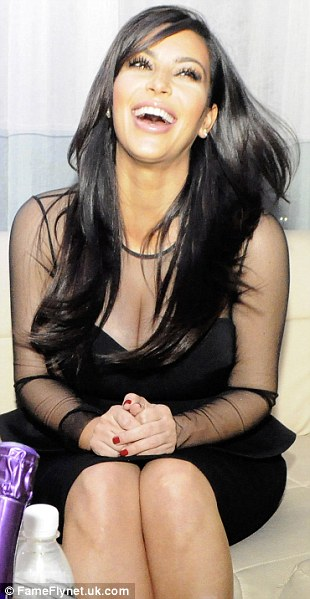 In happier mood: Kim seemed to be having a good time as she attended a party at Life Star Nightclub in Abidjan, Cote d'Ivoire
