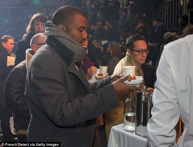 Tea for one? The lonely rapper took his mind off his absent girlfriend by joining the queue for a cup of coffee