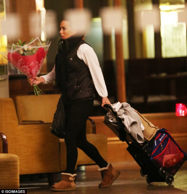 Congrats: Olympian Beth Tweddle clutched a large bouquet of flowers as she made her way back to the hotel