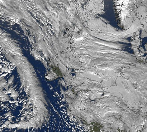 Swamped: This satellite image taken of Britain yesterday shows a huge sweeping band of snow heading north across Britain