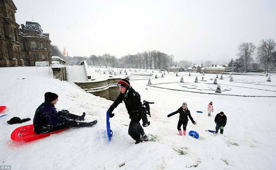 Lucky: Youngsters have a great time sledging down a slope at Bowes Museum in Barnard Castle, County Durham on a bonus day off school