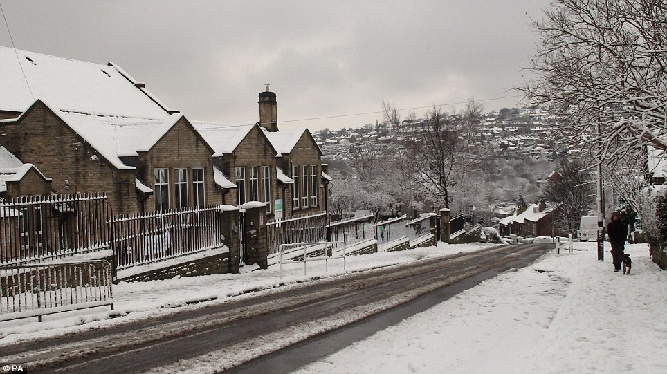 Slippery slope: A general view of Malin Bridge Primary School in Sheffield which was closed for the day as the winter weather continued across the UK