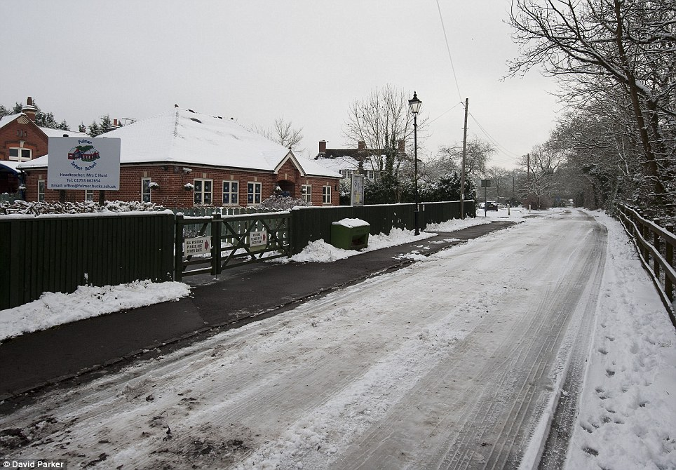 Shut gate: Fulmer Infant School in Fulmer, Buckinghamshire, was one of many schools closed due to the bad weather
