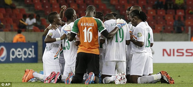 Needing help: Niger players prayed at half-time but they still lost 1-0 to Mali