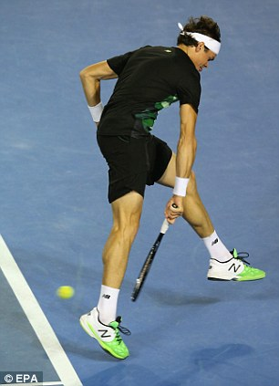 Out of reach: Milos Raonic had no answer for the Swiss great, however hard he tried (below right)
