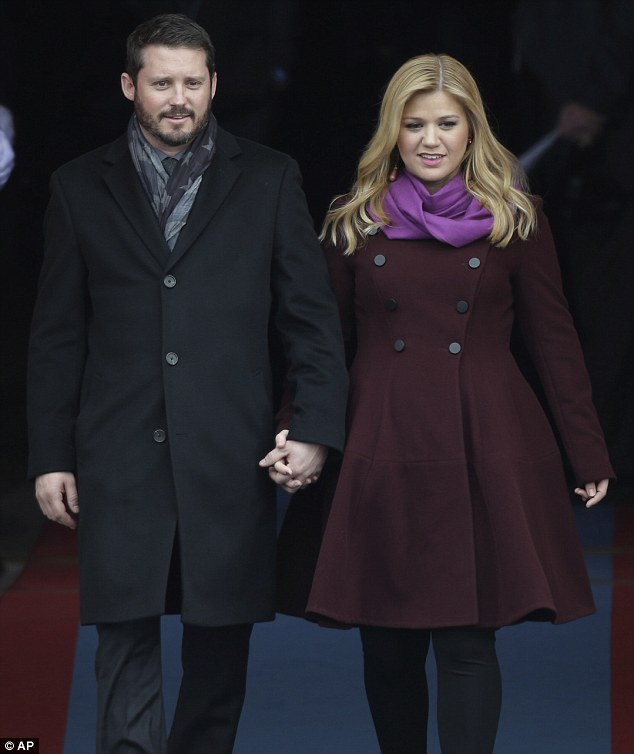 Historic day: Kelly Clarkson arrives with Brandon Blackstock for the ceremonial swearing-in of President Barack Obama
