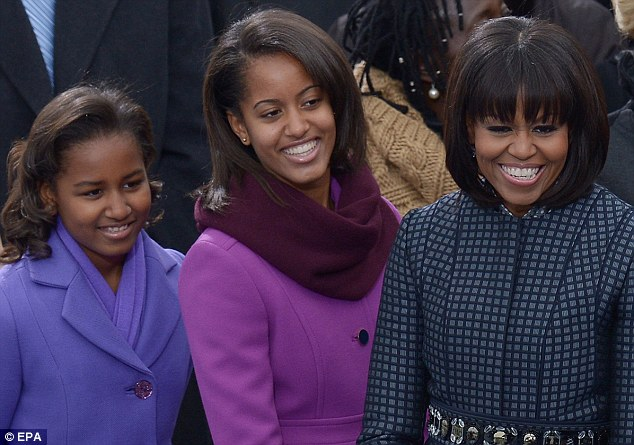 His biggest supporters: First Lady Michelle Obama and her daughters Sasha and Malia