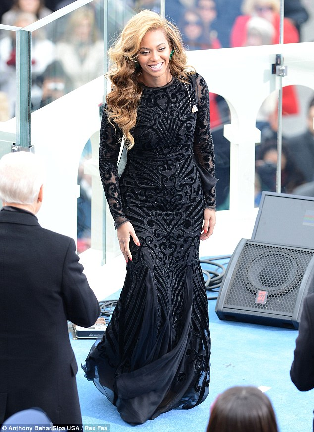 Natural beauty: Beyonce's  Emilio Pucci black velvet and chiffon beaded cutout long-sleeved gown from the Pre-Fall 2013 collection was perfect for the ceremonial atmosphere