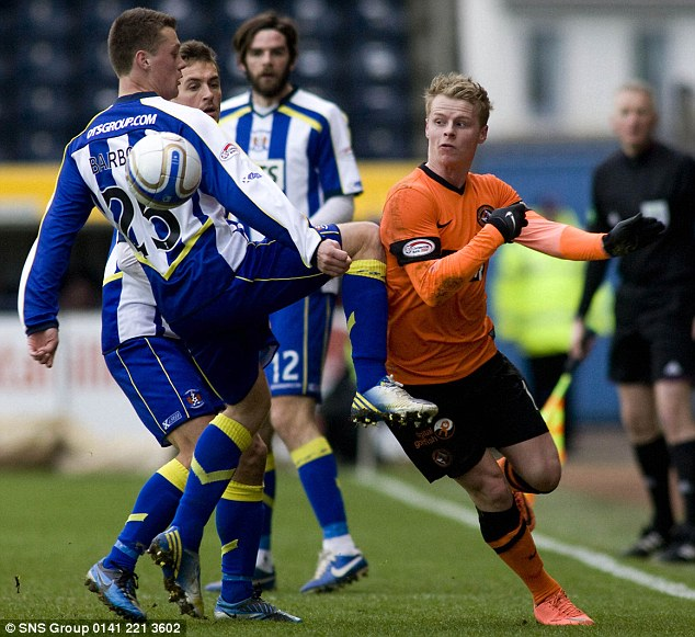 Silky: Gary Mackay-Steven (right) tricks his way past three Kilmarnock players at Rugby Park