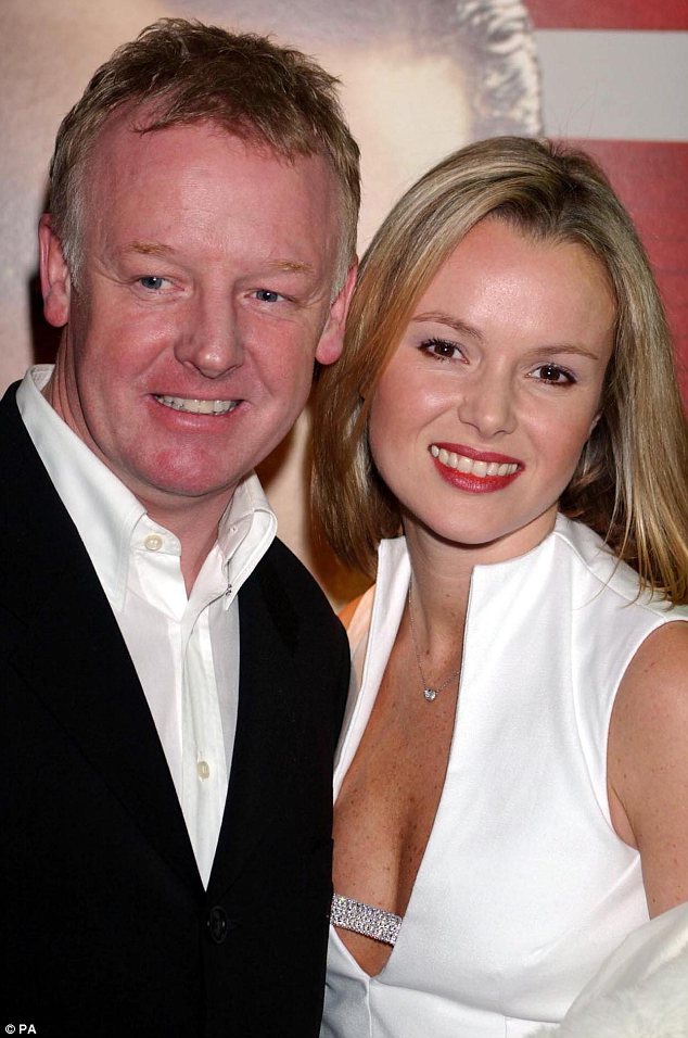 Old love: Amanda was married to the Family Fortunes host for eight years before the pair divorced in 2003. Pictured together in 2001