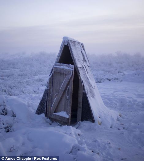 A toilet on the tundra at a petrol stop on the road to Oymyakon