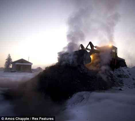 A digger delivers fresh coal to the heating plant in Oymyakon