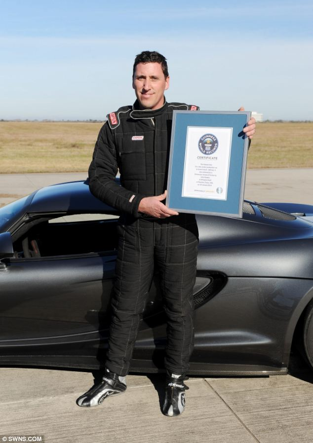 Driver John Kiewicz with the Guinness World record award on the Houston runway where the record was set