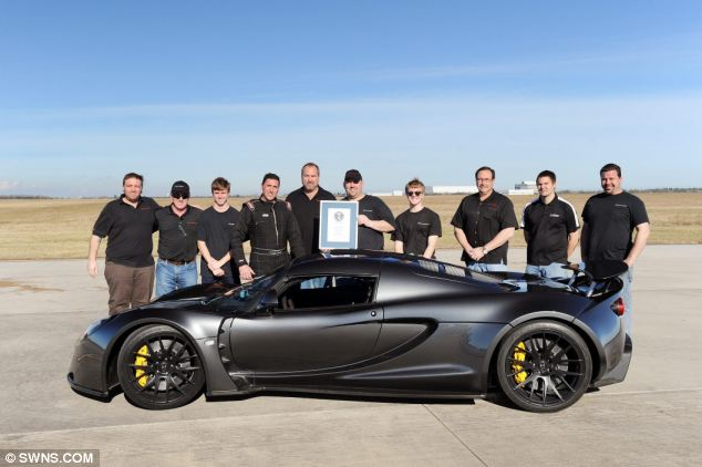 The Hennessey team with the Guinness World record award. Their Venom GT rocketed from 0-186mph (300kph) in 13.63 seconds - the same time it takes a diesel Ford Fiesta to hit 60mph. Guinness World Records were there to verify the time