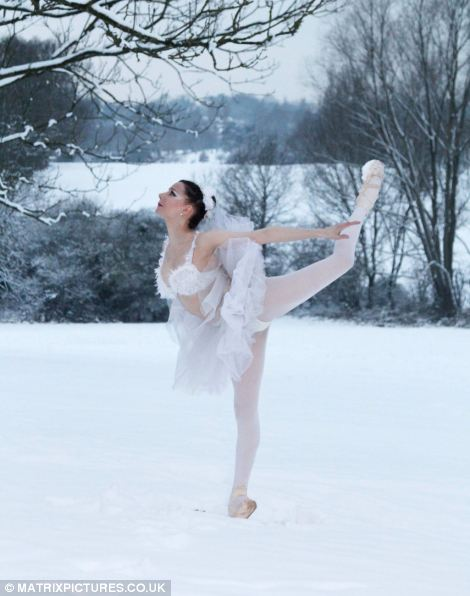 English ballerina Rebecca Sewell is pictured dancing in the snow in Barnet, London