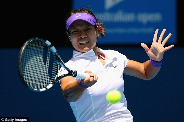 Determined: Li returns a shot to Radwanska during her win over the Pole
