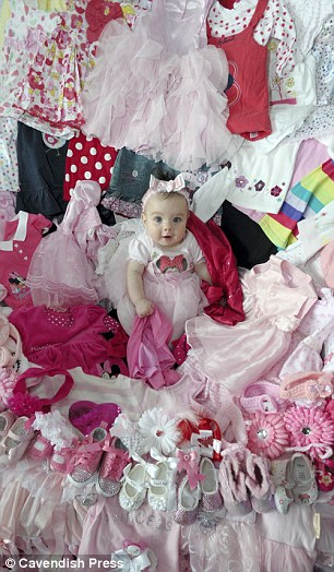 Baby Princess surrounded by her clothes