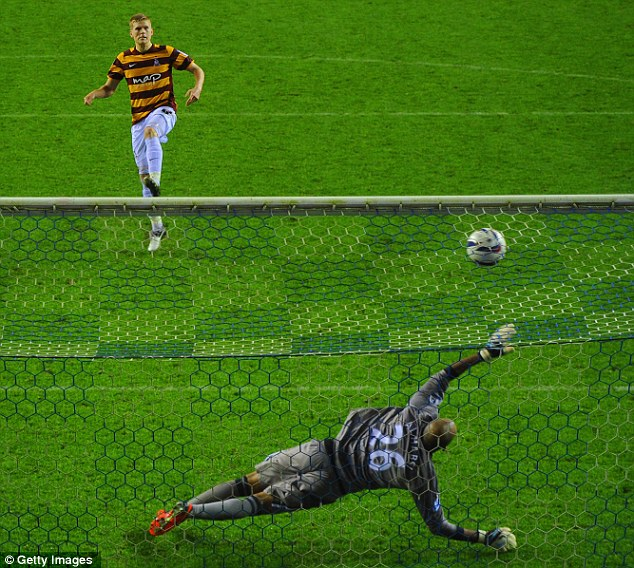 Out of reach: Alan Connell scores a penalty in the shootout during Bradford's meeting with Wigan