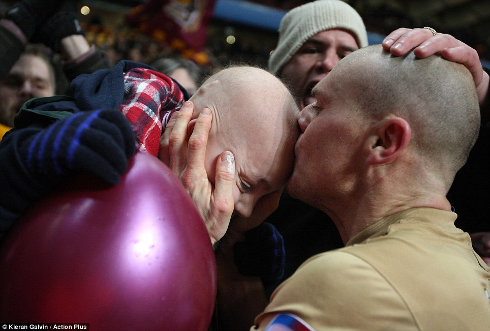 Picture perfect: Bradford skipper Gary Jones admitted to feeling emotional when seeing this picture of him planting a kiss on young Bradford fan Jake Turton - who has survived a brain tumour