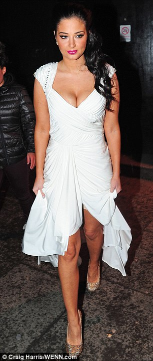 It was all going so well... Tulisa tried to keep her almost knee-length slimming aid covered