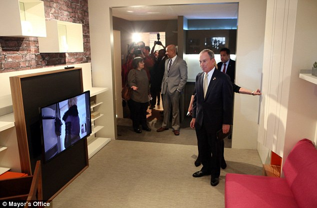 Neat design: Mayor Bloomberg surveys the living space of the new apartment design which will be part of a new exhibition at the Museum of the City of New York