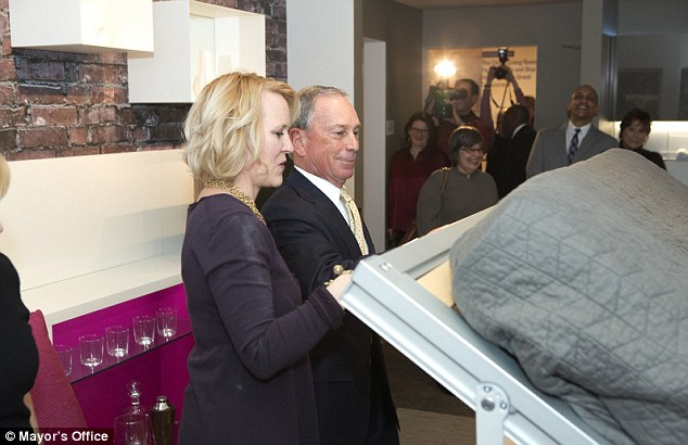 On board: Bloomberg tries the foldaway bed at the apartment which he backed as part of New York's way of adapting for the future