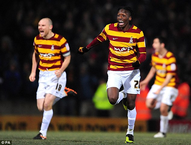 Job done: Bradford players wheel away in jubilation after scoring the decisive penalty