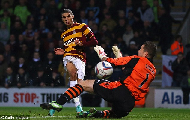 On our way: Nahki Wells scores the opener as Bradford are sent on their way to a 3-1 win