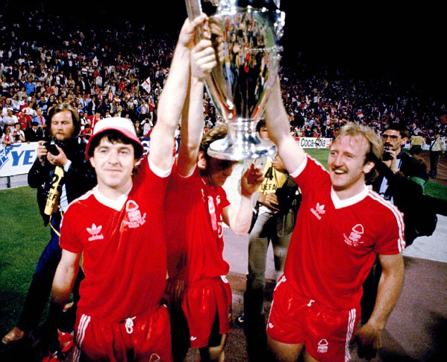 Enchanted Forest: JohnRobertson (left) and Kenny Burns hold the European Cup