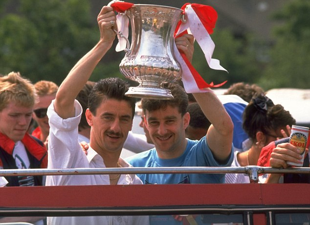 Kop idols: Ian Rush (left) and John Aldridge hold the FA Cup, which Liverpool won just five weeks after the Hillsborough tragedy (below)