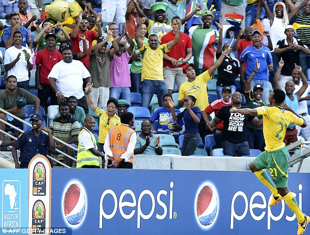 Crowd pleaser: Sangweni celebrates with the fans in Durban after scoring for South Africa