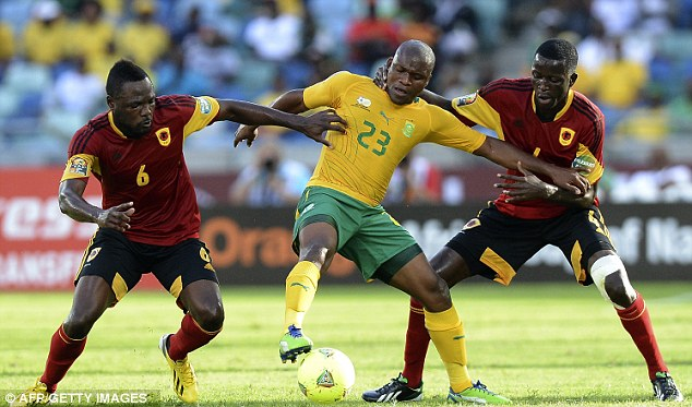 Doubling up: South African Tokelo Rantie tries to hold off Angola pair Fabricio (left) and Dede